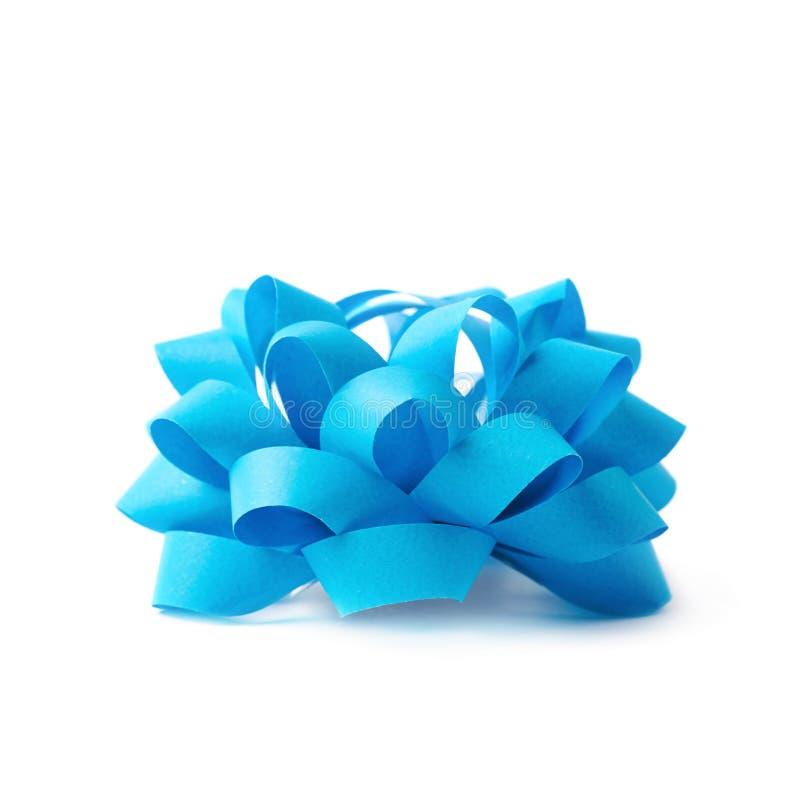 Decorational ribbon gift bow isolated. Decorational blue ribbon gift bow isolated over the white background royalty free stock images