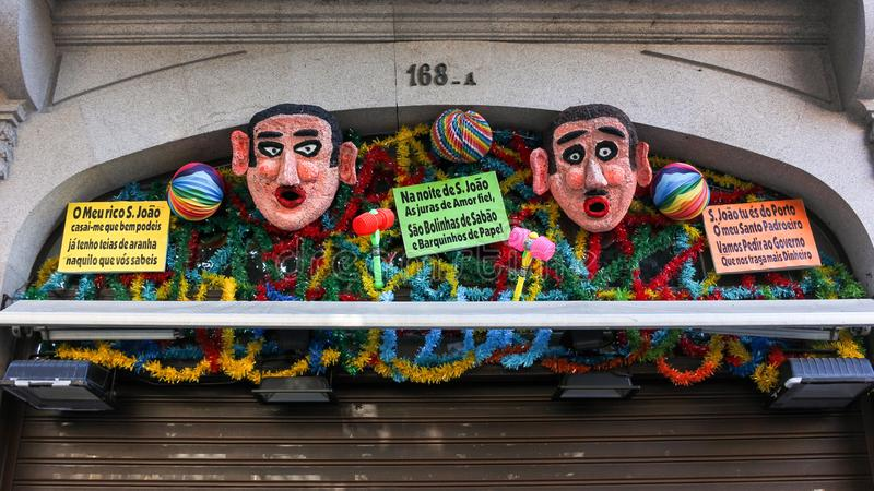 Festival decorations above a shopfront in Porto, Portugal royalty free stock image