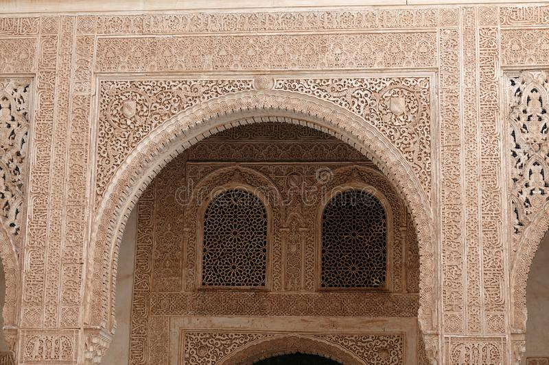 Moorish decorations at Nasrid palace  at the Alhambra in Granada, Andalusia. Decorations with arabesque ornaments at the Palacio Arab at the Court of the Myrtles royalty free stock image