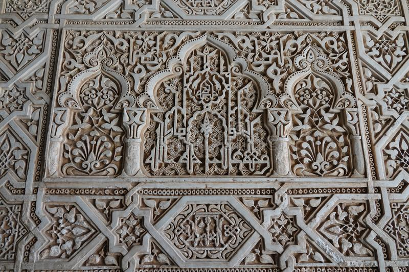 Moorish decorations at Nasrid palace of the Alhambra in Granada, Andalusia. Decorations with arabesque ornaments at the Palacio Arab at the Court of the Myrtles stock images