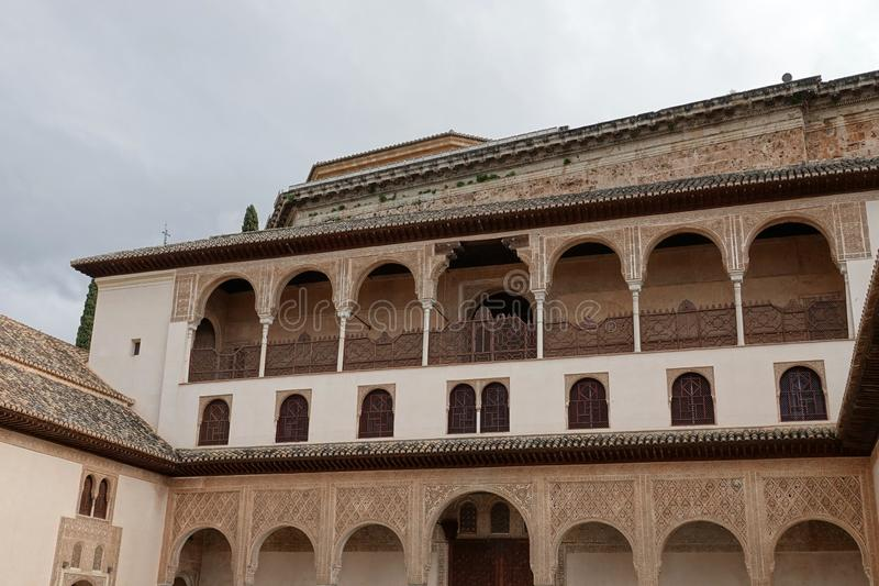 Palacio de Comares at Nasrid palace  at the Alhambra in Granada, Andalusia. Decorations with arabesque ornaments at the Palacio De Comares at the Court of the royalty free stock photography