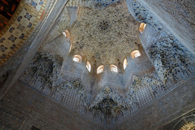 Hall of the Abencerrajes ceiling at Nasrid palace of the Alhambra in Granada, Andalusia. Decorations with arabesque ornaments in stalactite dome forming an eight stock image