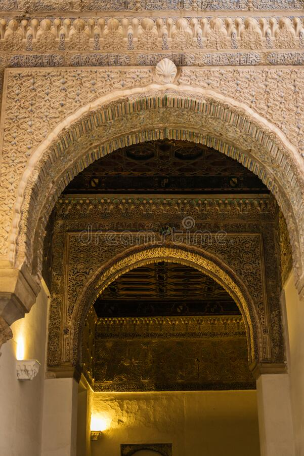 Decorations of the arches in Alcazars of Seville stock images