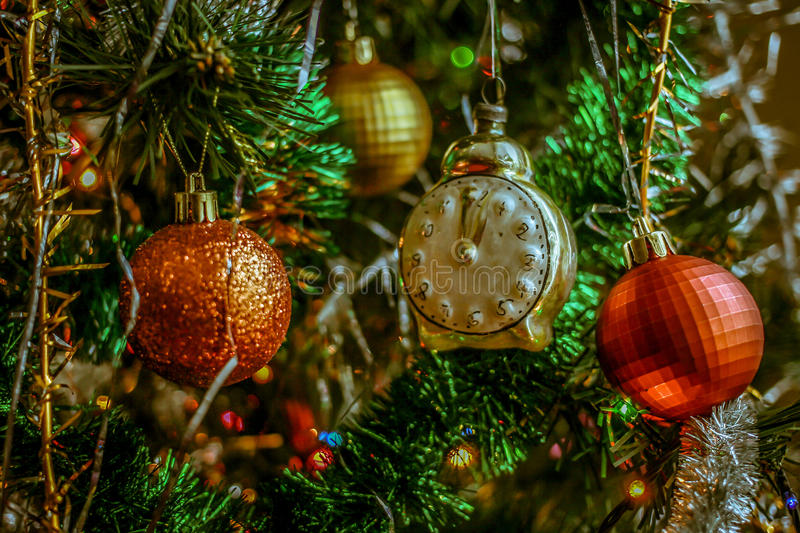 Download Decorations On The Christmas Tree - Colored Balls, Clock, Garlands And Lights Stock Photo - Image: 83713279