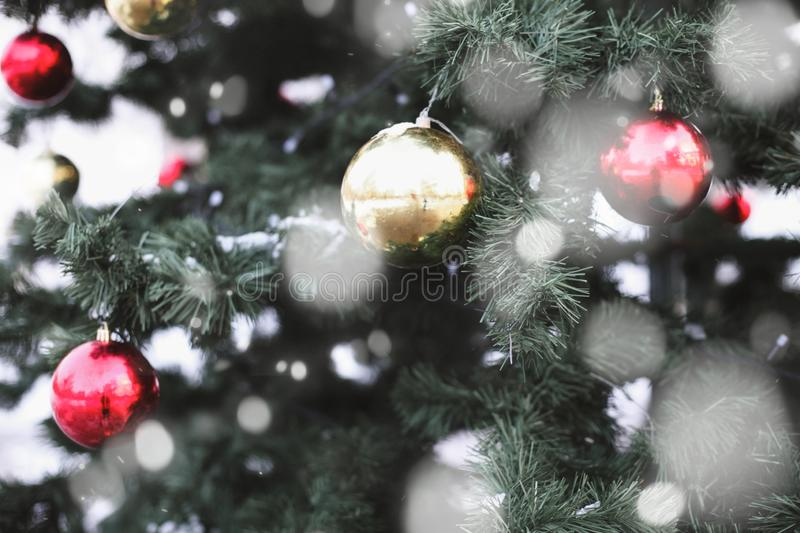 Decorations on the Christmas tree, toys, snowflakes, winter festive background and texture royalty free stock photography