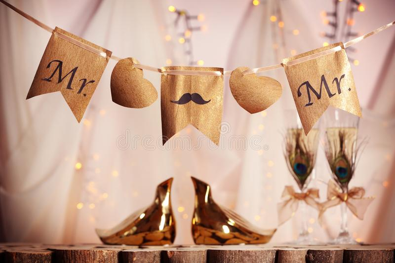 Decorations for gay wedding. On blurred background royalty free stock photo