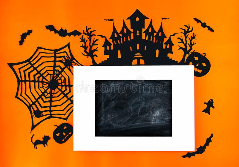 Decorations for Halloween party. Handmade paper decor. Festive greeting card, poster, banner design. Spider web, pumpkin, bat, cats, ghosts and spiders on royalty free stock photography