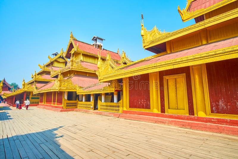 The restored buildings of Royal Palace in Mandalay, Myanmar. The decorations of Royal Palace`s buildings amaze with detail carving of the elements, Mandalay stock photos