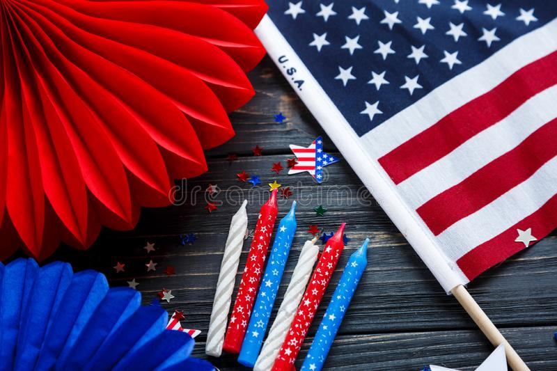 Decorations for 4th of July day of American independence, flag, candles, straws. USA holiday decorations on a wooden background royalty free stock photos