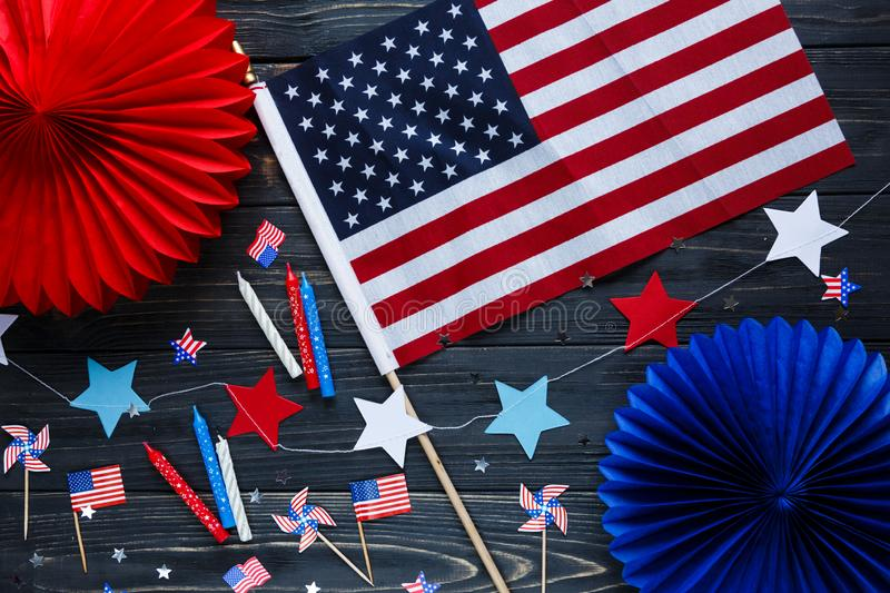 Decorations for 4th of July day of American independence, flag, candles, straws. USA holiday decorations on a wooden background stock photography