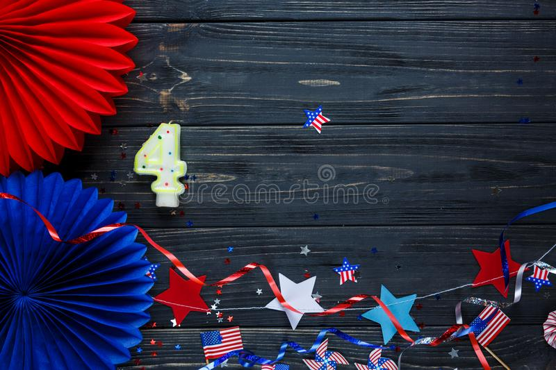 Decorations for 4th of July day of American independence, flag, candles, straws. USA holiday decorations on a wooden background. Top view, flat lay royalty free stock photography