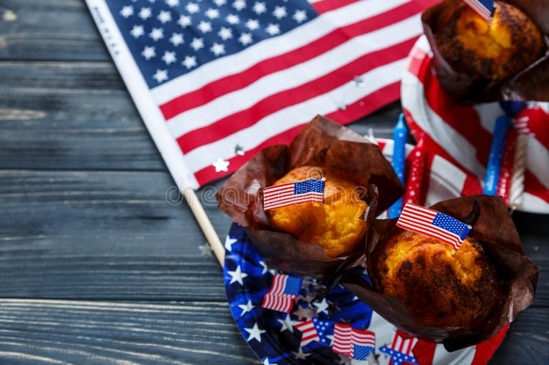 Decorations for 4th of July day of American independence, flag, plates with muffins. USA holiday decorations stock photography