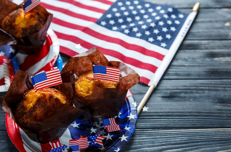 Decorations for 4th of July day of American independence, flag, plates with muffins. USA holiday decorations stock photo