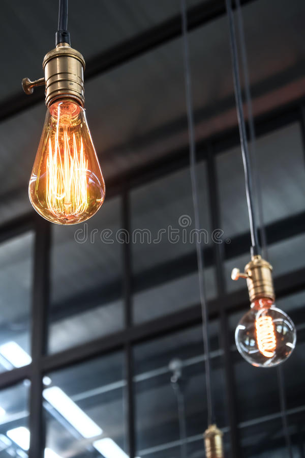 Decorative antique edison style light bulbs with factory materials background. Closeup of decorative antique edison style light bulbs with factory materials royalty free stock photo
