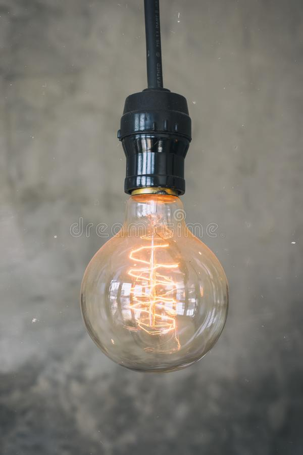 Decorative antique edison style light bulbs.Vintage light bulbs hanging from the ceilings royalty free stock images