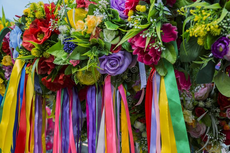 Decorative artificial flowers and ribbons. For holidays royalty free stock photography