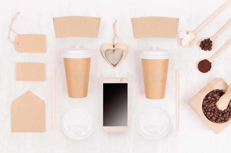 Decorative background for restaurant and coffee shop - two blank paper cups, phone, label, heart, coffee beans on white wood board stock image