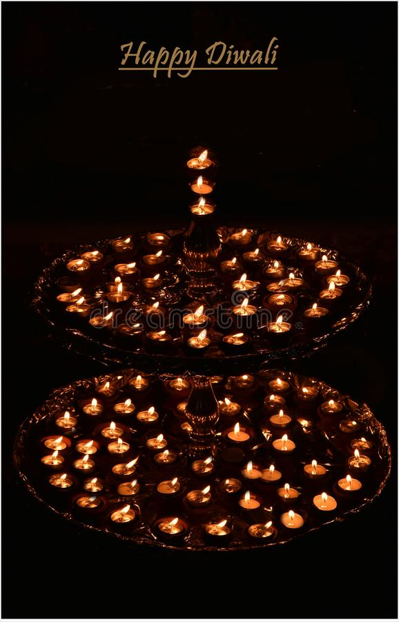 Decorative beautiful traditional Diwali Diya or lamps ideal for Diwali card or greetings. Decorative beautiful traditional Diwali Diya or lamps decorated in stock images