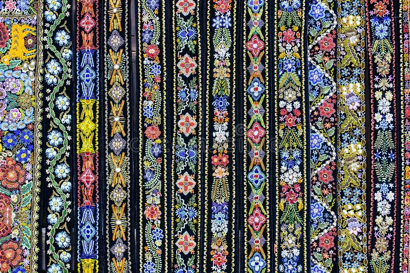 Decorative belts colorful background. Multiple clothing accessories , decorative belts handcrafted with intricate geometric patterns