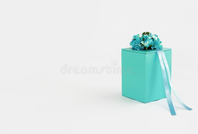 Decorative blue gift box with flower and ribbon designs royalty free stock image