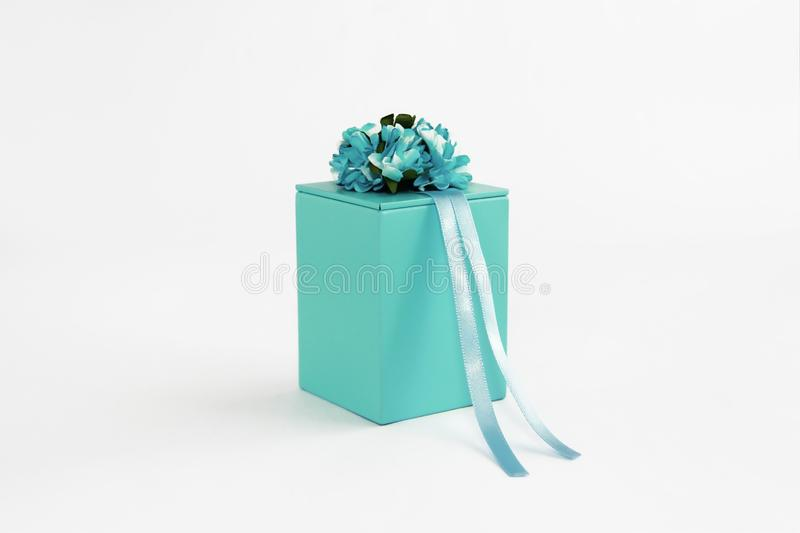 Decorative blue gift box with flower and ribbon designs stock photo