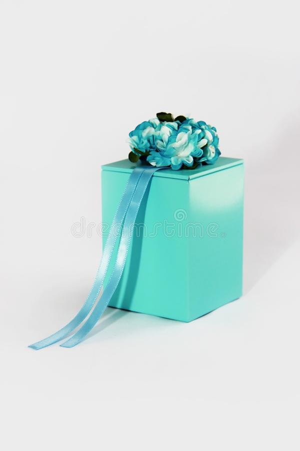Decorative blue gift box with flower and ribbon designs royalty free stock photos