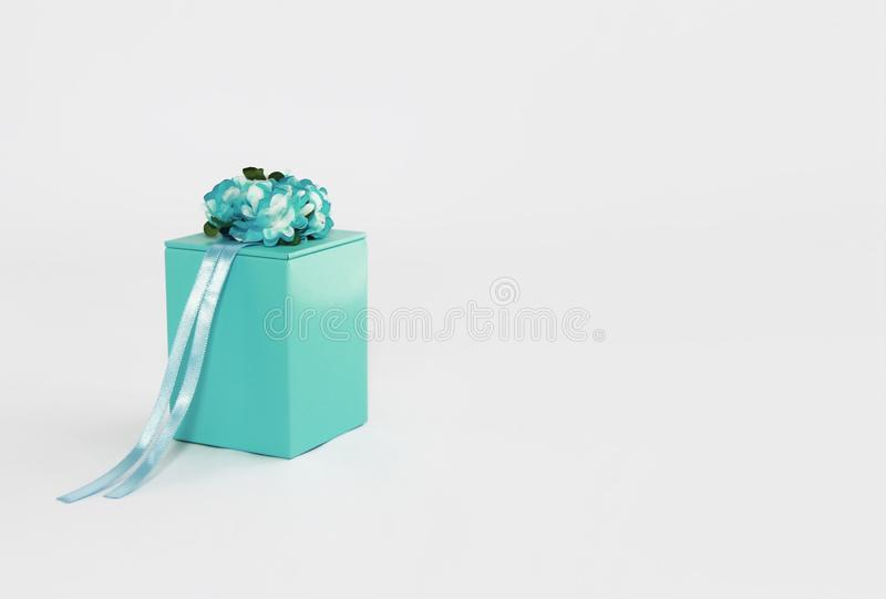 Decorative blue gift box with flower and ribbon designs royalty free stock photo