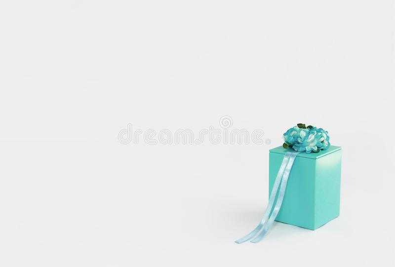 Decorative blue gift box with flower and ribbon designs stock image