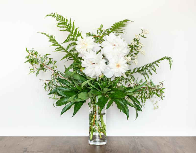 Decorative Bouquet of White Peonies in a Glass Vase. stock image