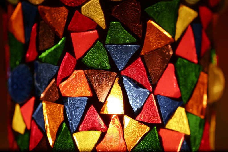 Decorative candle holder. Candle holder made of coloured glass pieces royalty free stock photo
