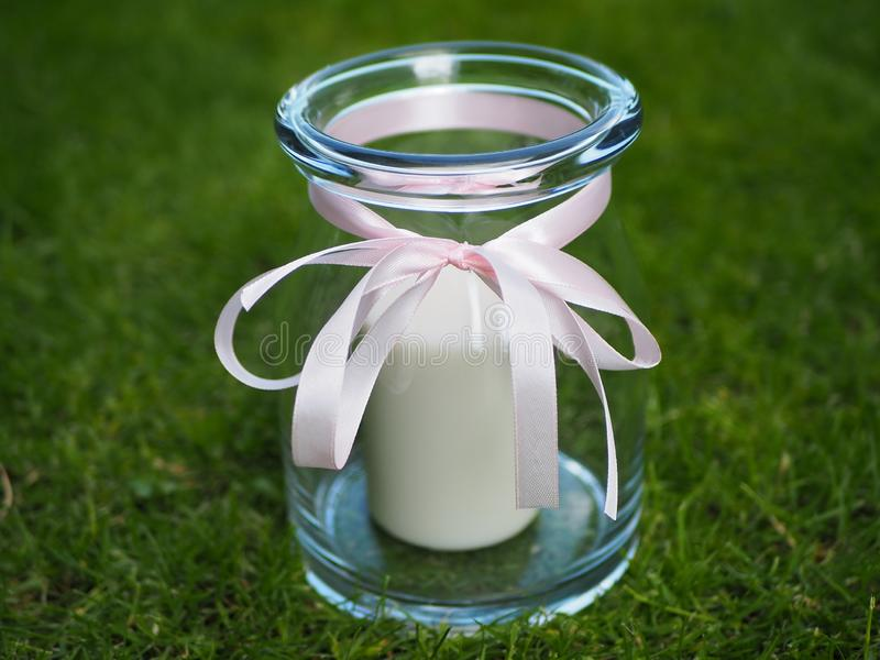 Decorative candle holder jar with pink bow royalty free stock image