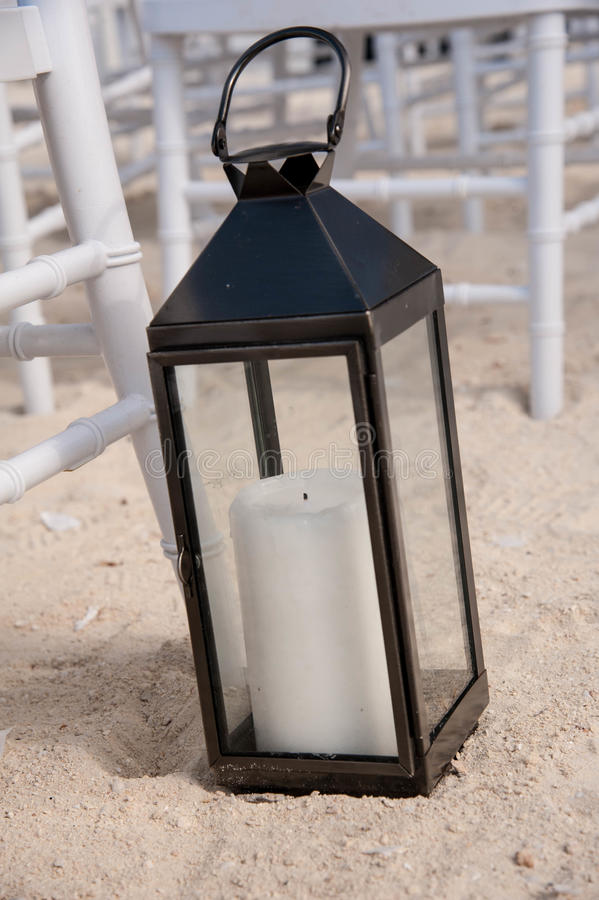 Decorative Candle Lantern on a Sandy Beach stock images