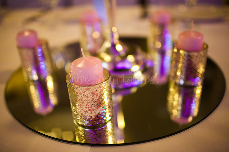 Decorative candles. On the tables stock photo