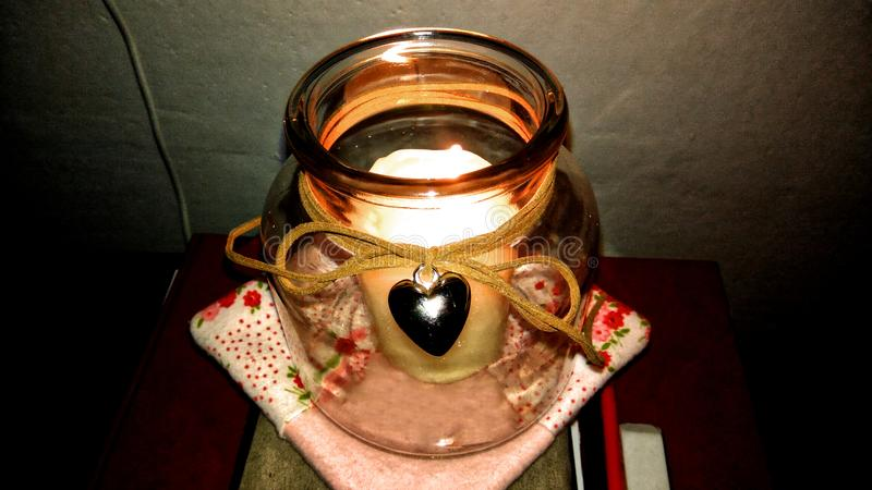 Decorative candlestick with heart in the dark. royalty free stock photo