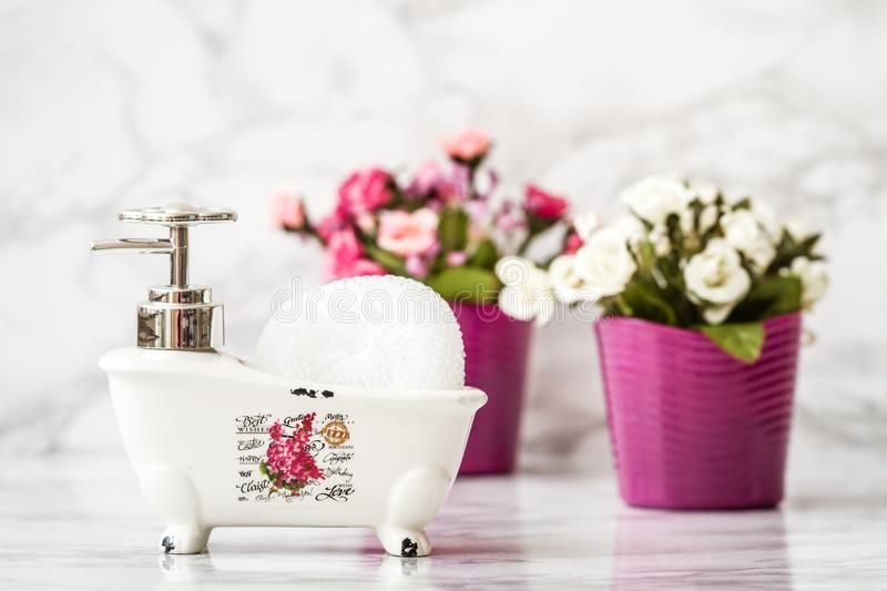 Decorative Ceramic Mini Claw Foot Bathtub Soap Dish with Bath Sp. Onge royalty free stock photo