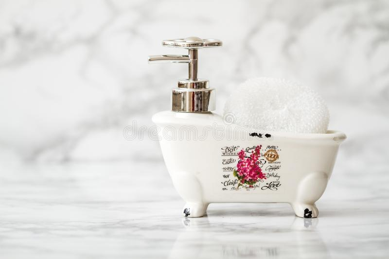 Decorative Ceramic Mini Claw Foot Bathtub Soap Dish with Bath Sp. Onge stock images