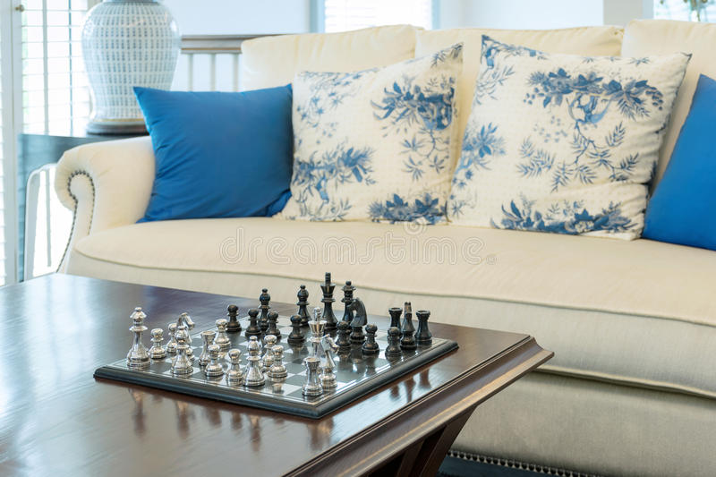 Decorative chess board with chess pieces in luxury living room stock image