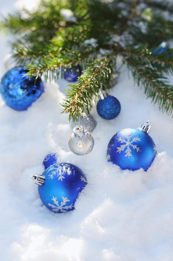 Decorative Christmas balls on the snow and brunch of Christmas tree outdoor royalty free stock images