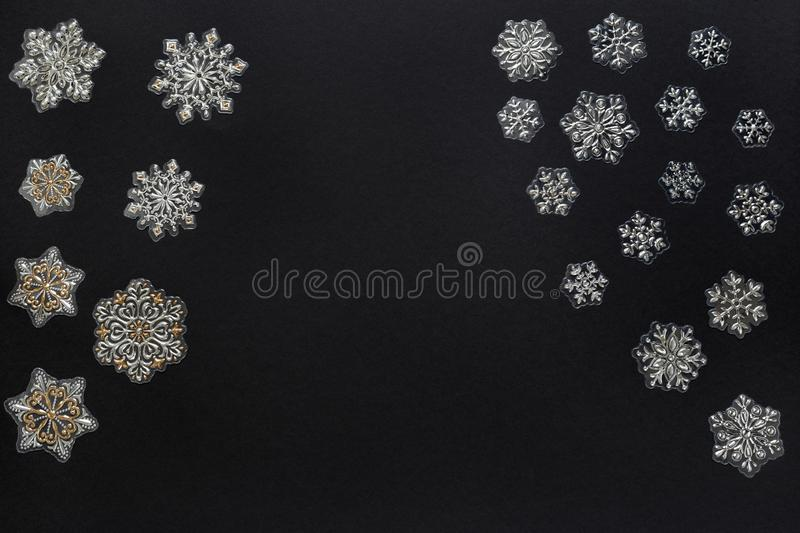 Decorative christmas snowflakes isolated on black background. Concept of Christmas and new year. Copy space for text royalty free stock image