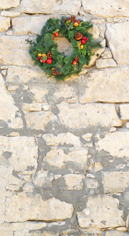 Download Decorative Christmas Wreath On A Vintage Stone Wall Stock Image - Image: 16960079