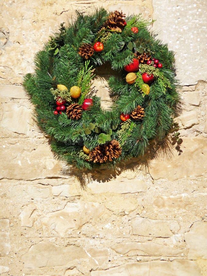 Decorative Christmas wreath on vintage stone wall