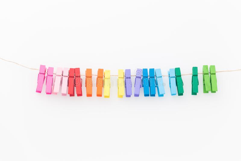 Decorative clips in different colors for washing laundry isolated from the background. View of the decorative clips in different colors for washing laundry royalty free stock image