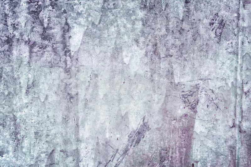 Decorative coating with an uneven texture. Old plastered wall with stains and scratches. Dark gray putty. Blank stock photography