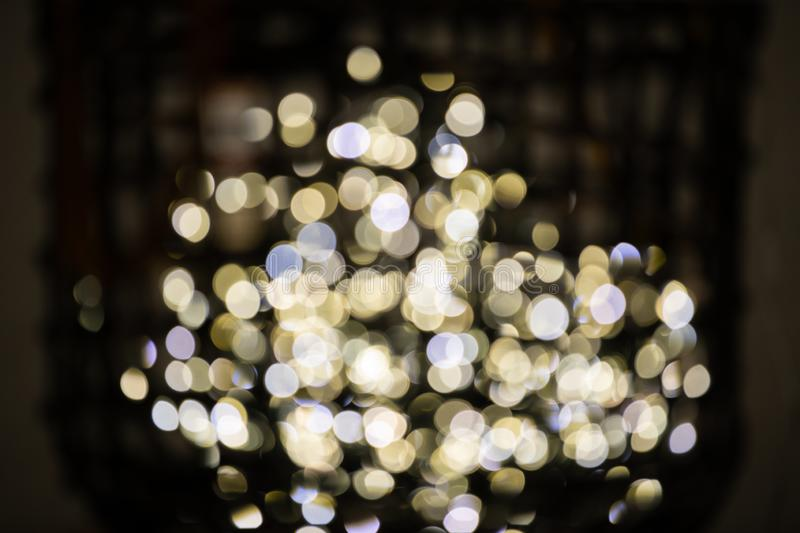 Decorative colored fairy lights blurred with bokeh on display in a basket close up stock images