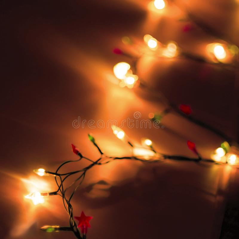 Decorative Colorful Blurred Christmas Lights On Dark Background. Abstract Soft Lights. Colorful Bright Circles Of A Sparkling Garl royalty free stock images