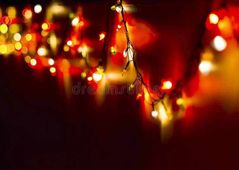 Decorative Colorful Blurred Christmas Lights On Dark Background. Abstract Soft Lights. Colorful Bright Circles Of A Sparkling Garl stock photography