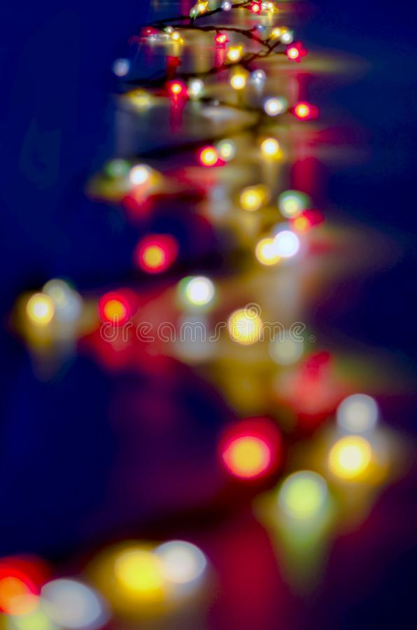 Decorative Colorful Blurred Christmas Lights On Dark Blue Background. Abstract Soft Lights. Colorful Bright Circles Of A Sparkling royalty free stock photos