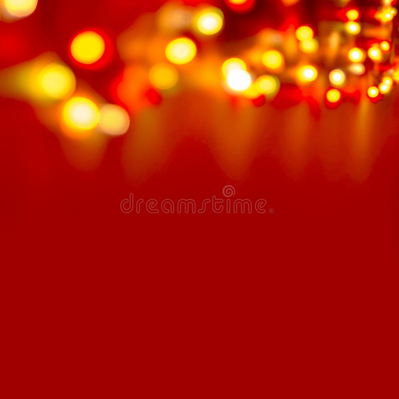 Decorative Colorful Blurred Christmas Lights On Red Background. Abstract Soft Lights. Colorful Bright Circles Of A Sparkling Garla royalty free stock photography