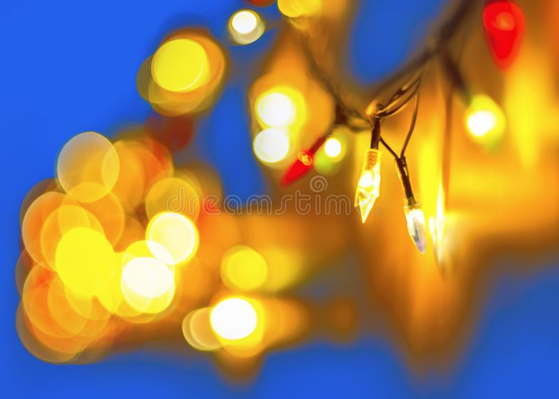 Decorative Colorful Blurred Lights On Blue Background. Christmas Abstract Soft Lights. Colorful Bright Circles Of A Sparkling stock photo