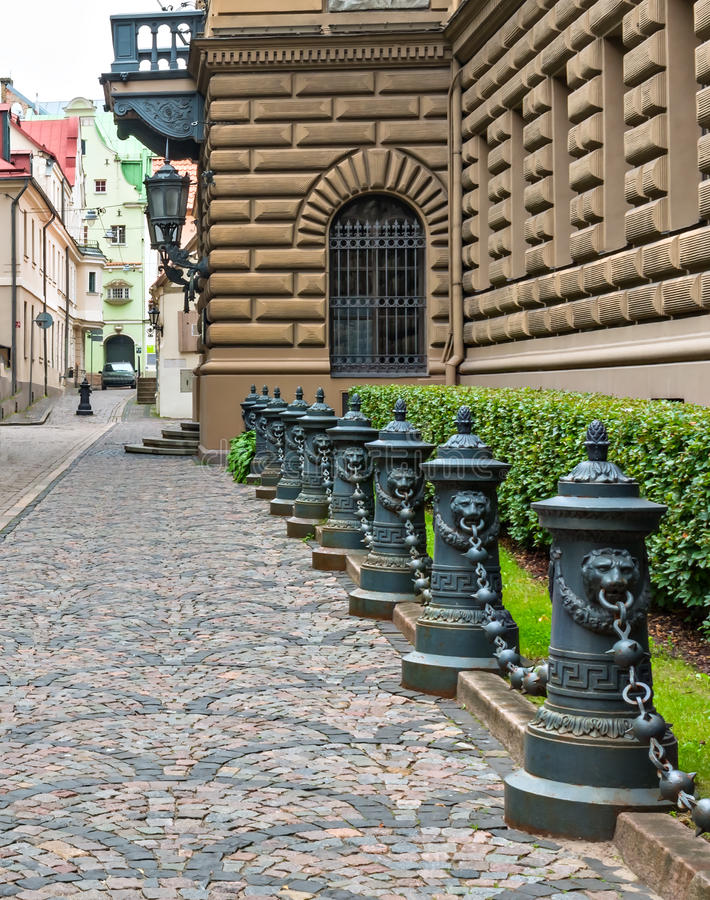 Decorative columns near a building of parliament of Latvia. Walking through medieval streets of old Riga tourists can feel unforgettable atmosphere of the Middle royalty free stock photography